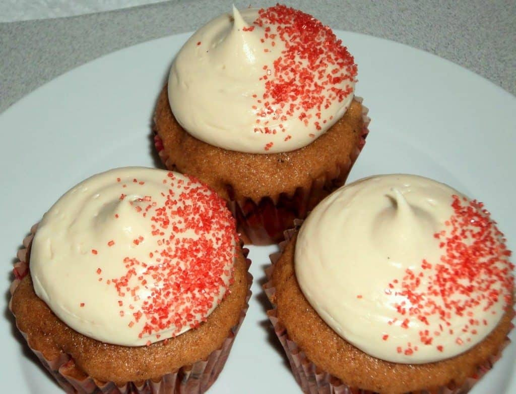 three tomato soup cupcakes on a plate