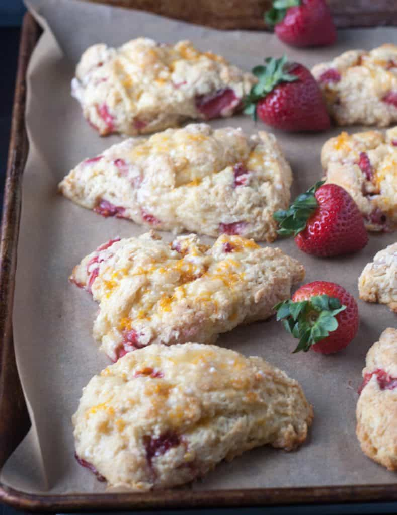strawberry scones on a cookie sheet