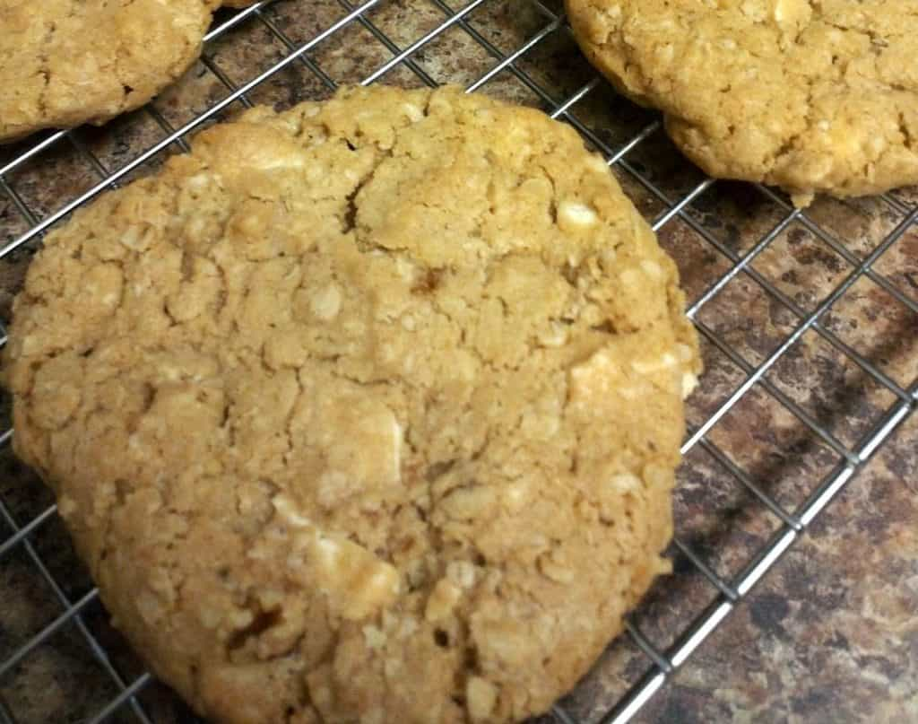 oatmeal white chocolate walnut cookie on a cooling wire rack