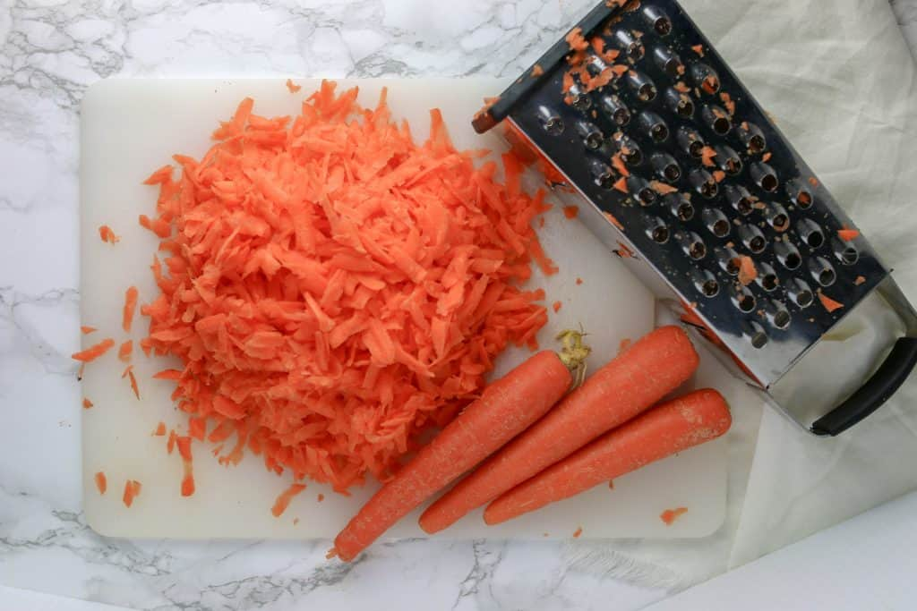 carrots grated on a cutting board