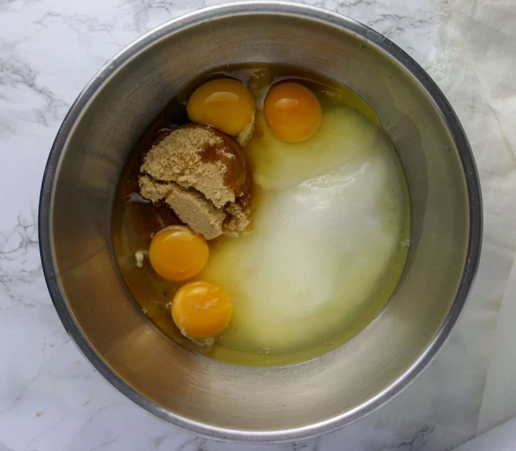 sugars, eggs, and oil in mixing bowl for carrot cake