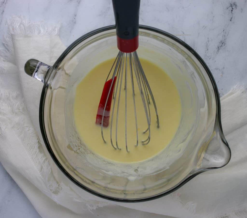 liquid ingredients whisked together in bowl for strawberry muffins
