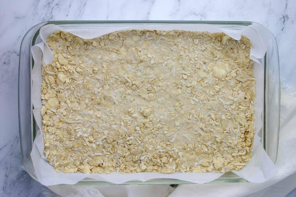 raspberry bar crust pressed into bottom of 9x13 pan