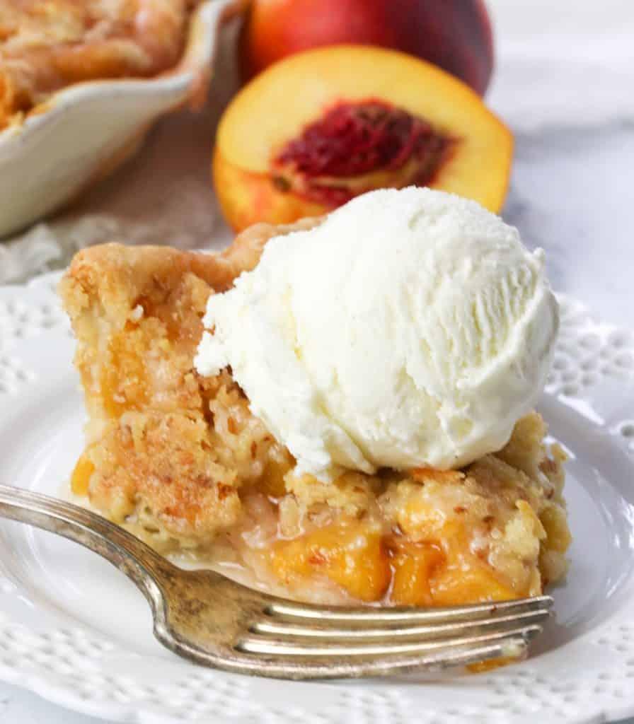 slice of nectarine pie with a scoop of icecream on top