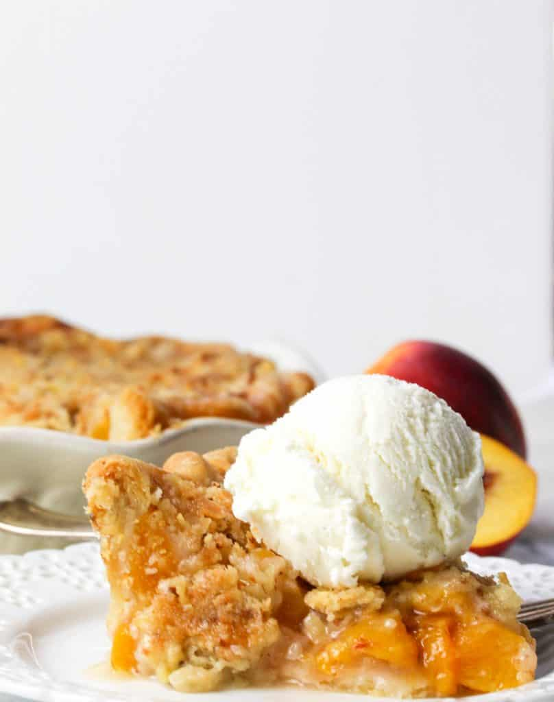 slice of nectarine pie with a scoop of ice-cream on top