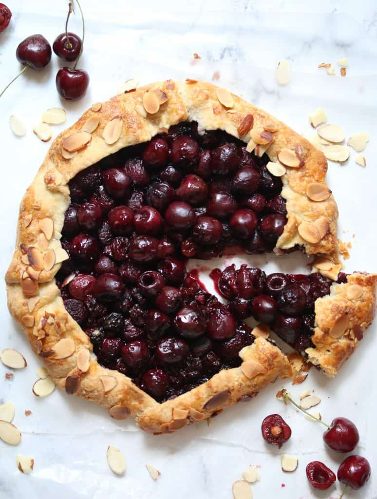 cherry crostata with a slice cut from it