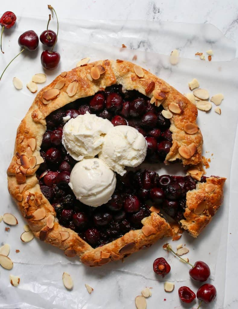 cherry crostata topped with three scoops of vanilla icecream