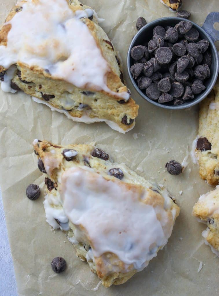 two chocolate chips scones on parchment paper