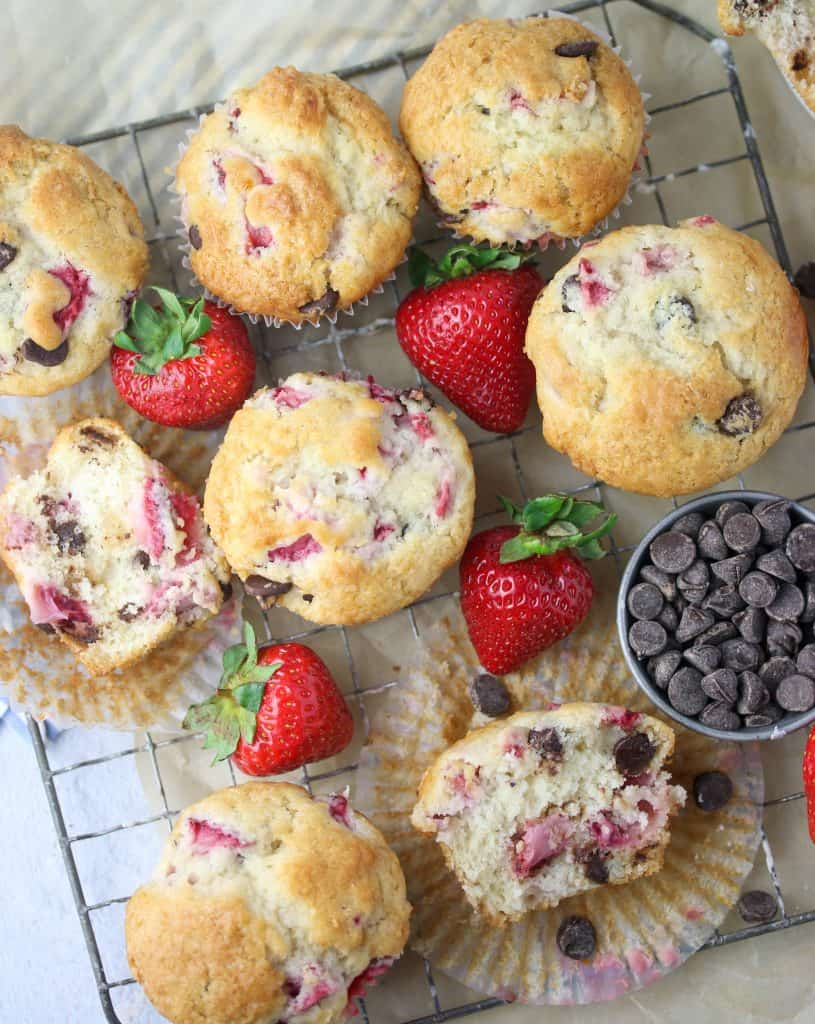 strawberry chocolate chip muffins on a cooling rack