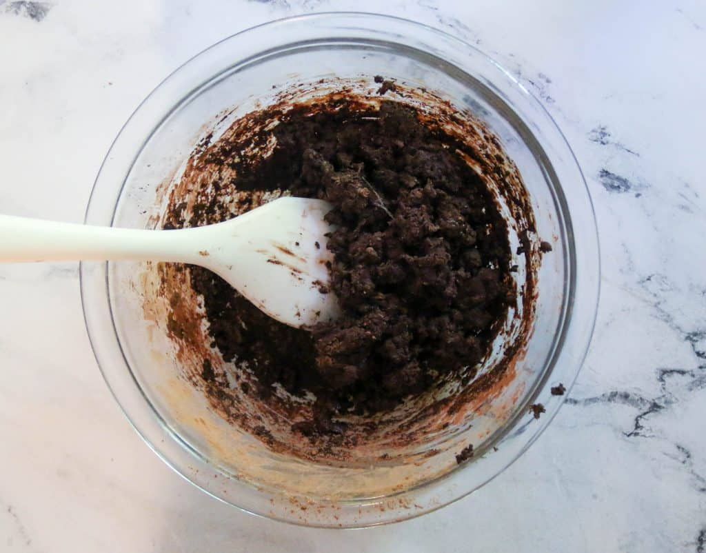 cocoa mixture in a bowl with a spatula