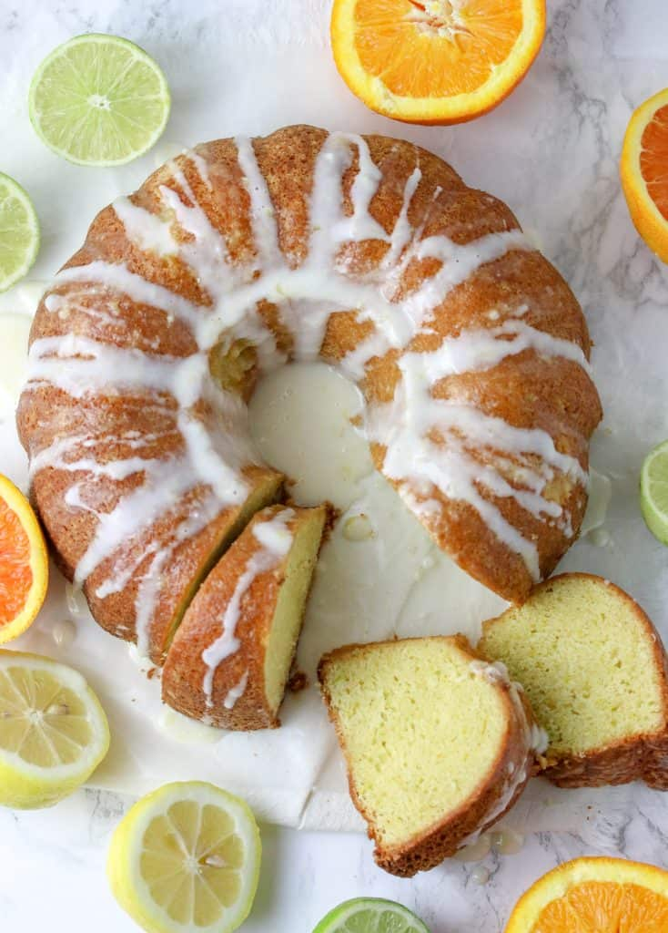 lemon pound cake sliced surrounded by different citrus