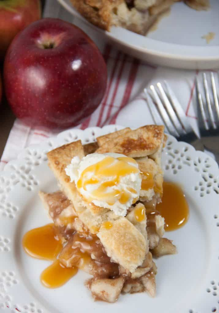 slice of apple pie topped with ice-cream