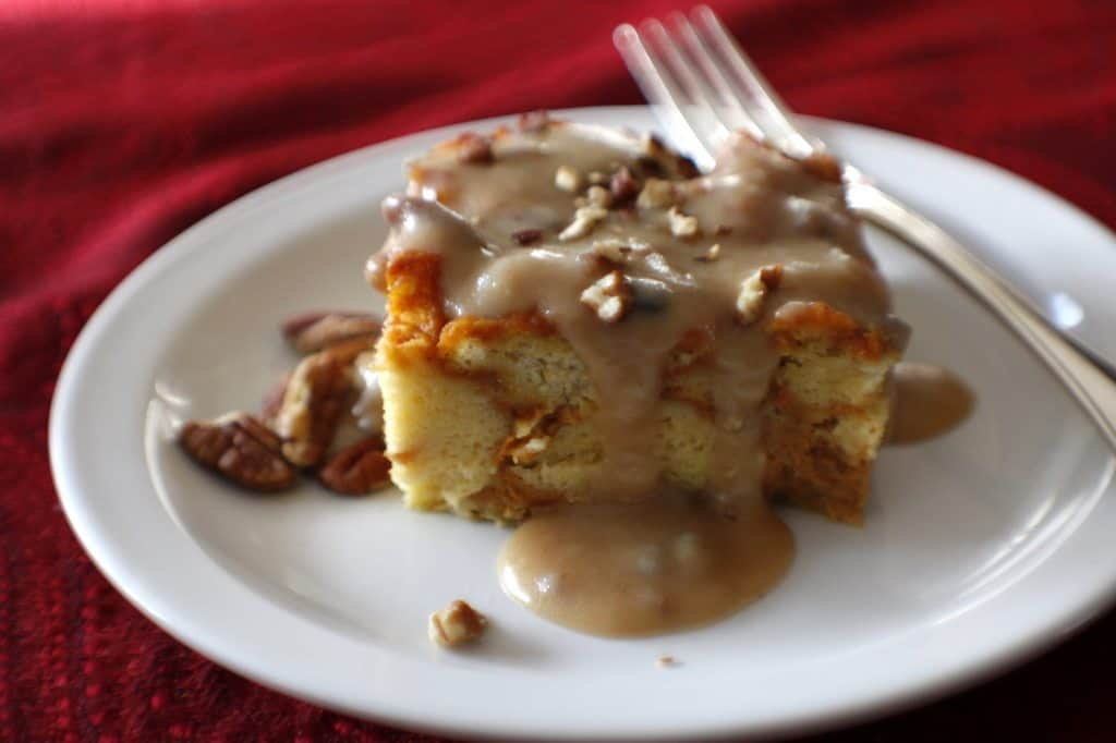 slice of pumpkin bread pudding on a plate with a fork