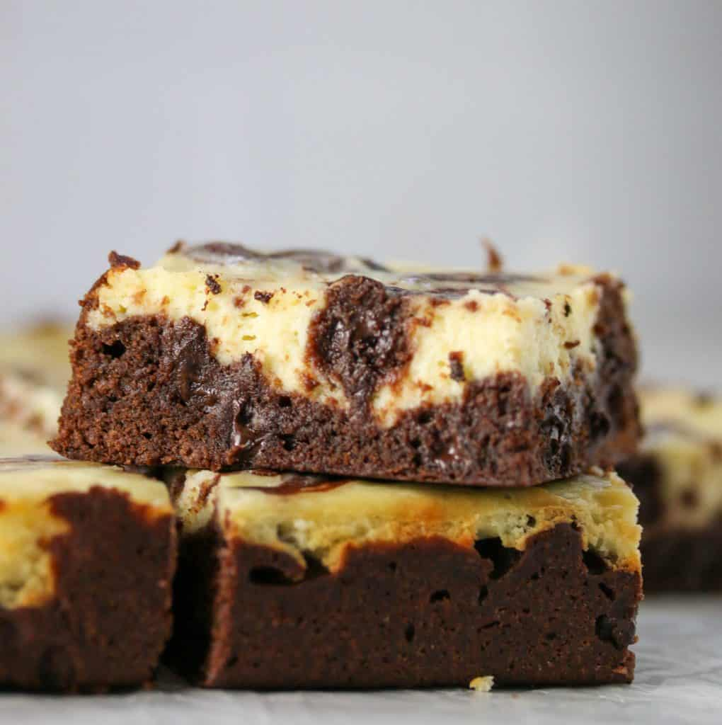 cheesecake brownie stacked on top of another one