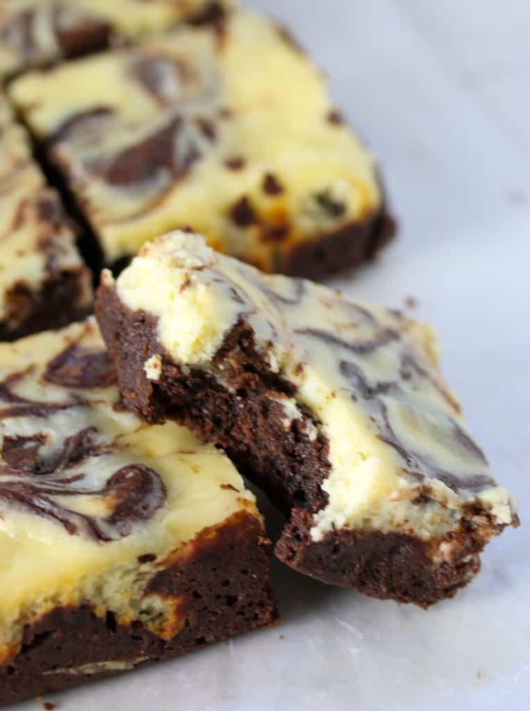 cheesecake brownie with a bite taken out of it