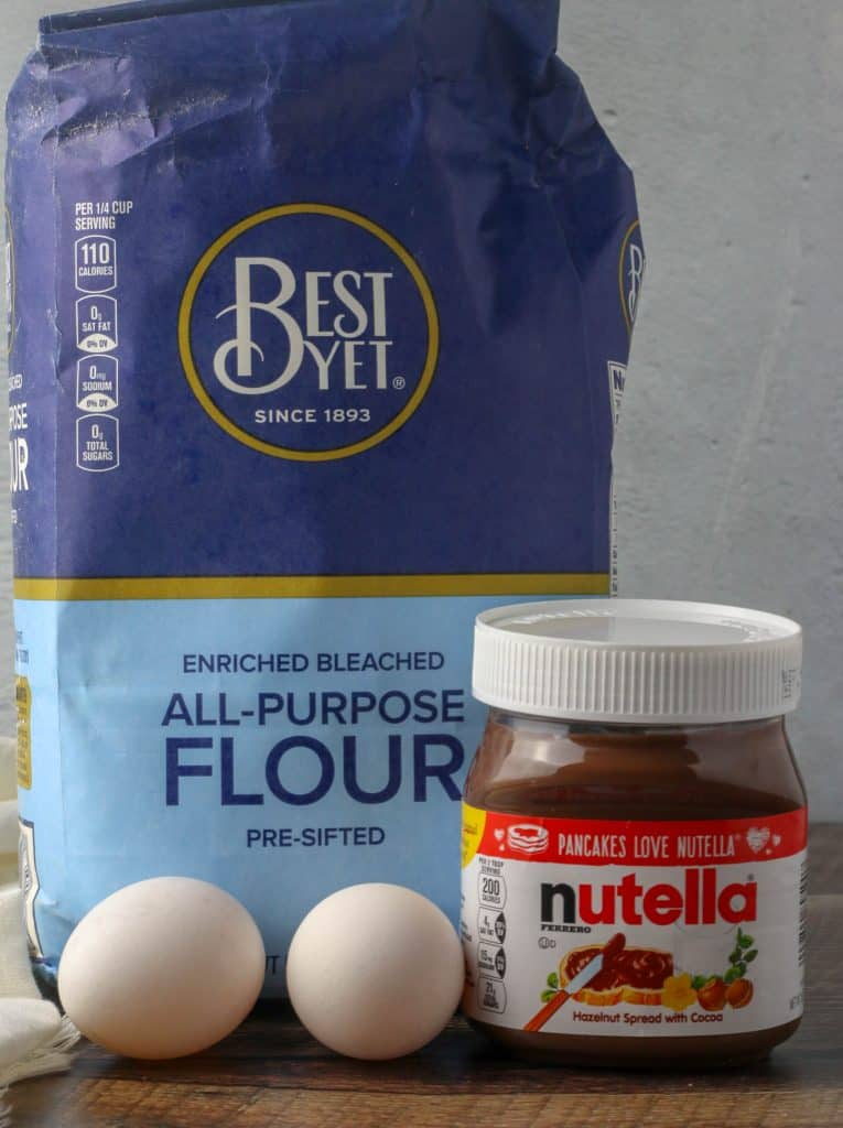 bag of flour, jar of Nutella, and 2 eggs