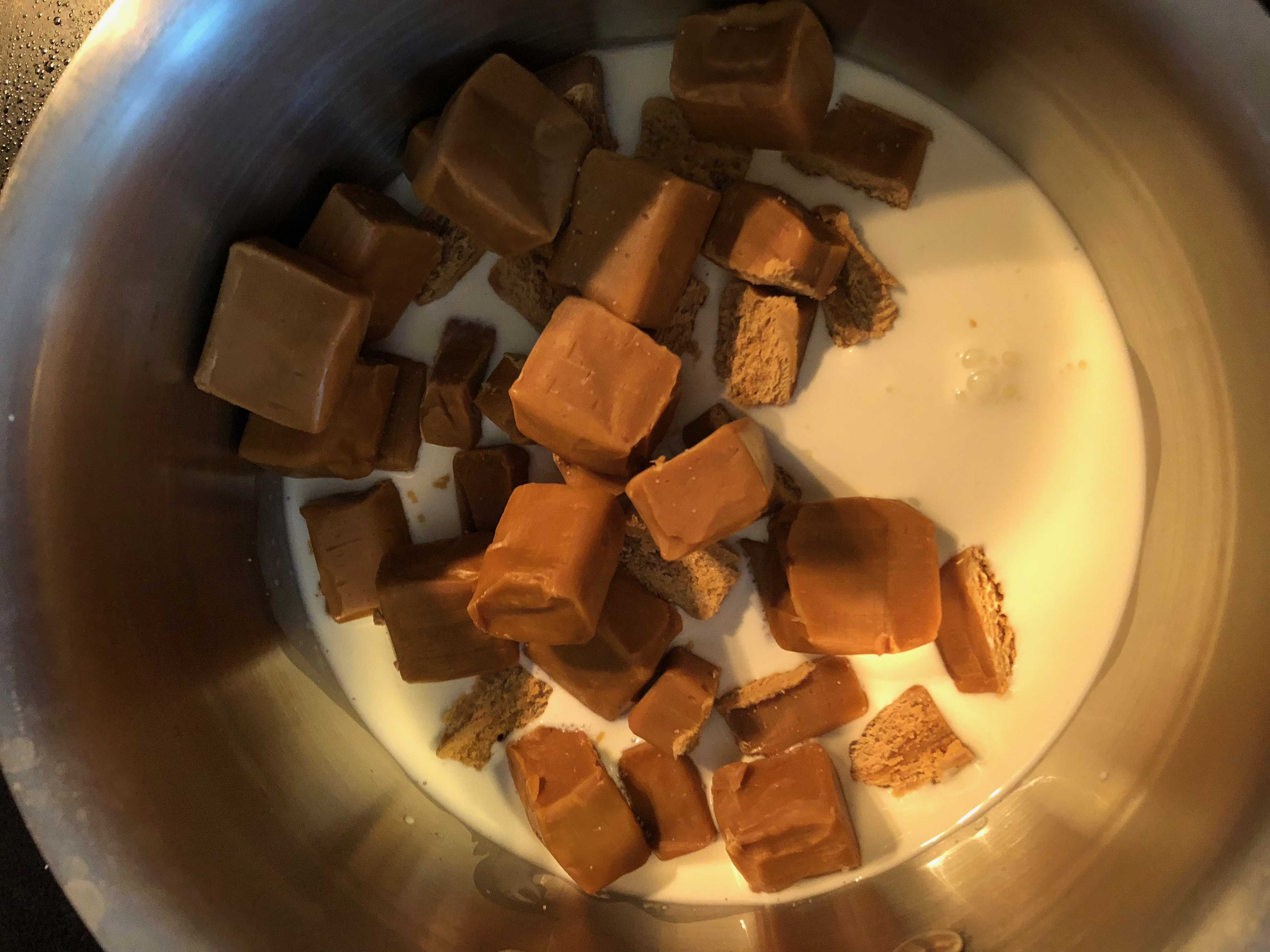 caramel candies and heavy cream in a saucepan