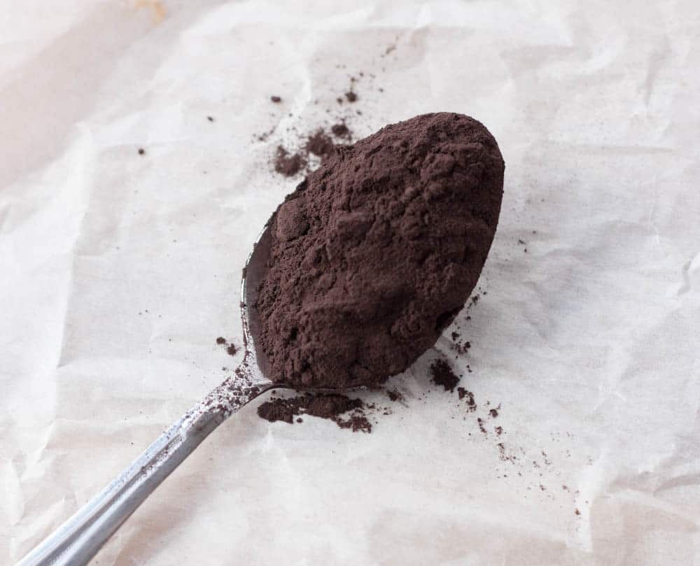black cocoa powder on a spoon