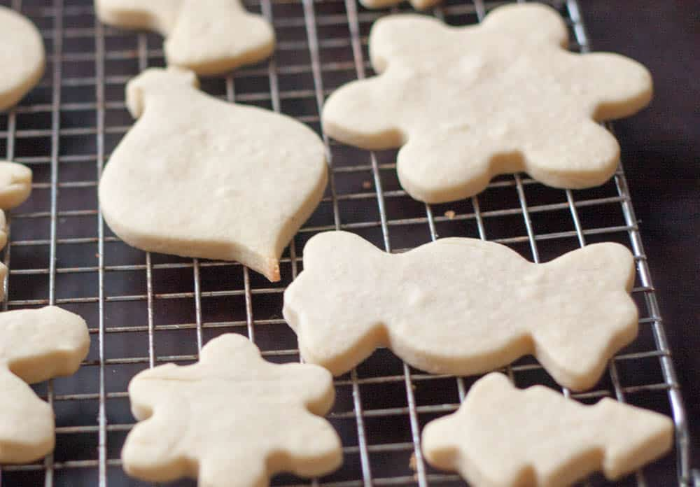 undecorated sugar cookies on a cooling rack