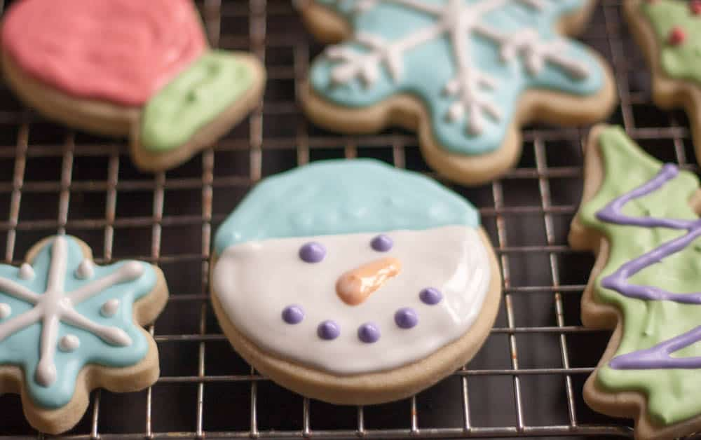 snowman sugar cookie on a cooling rack