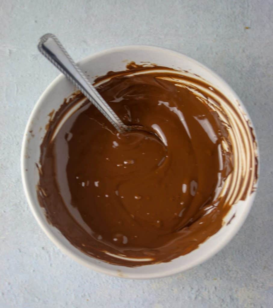 melted chocolate chips in a bowl with a spoon