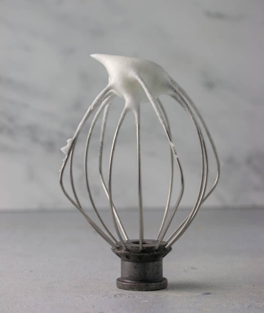 whisk attachment with whipped egg whites on it