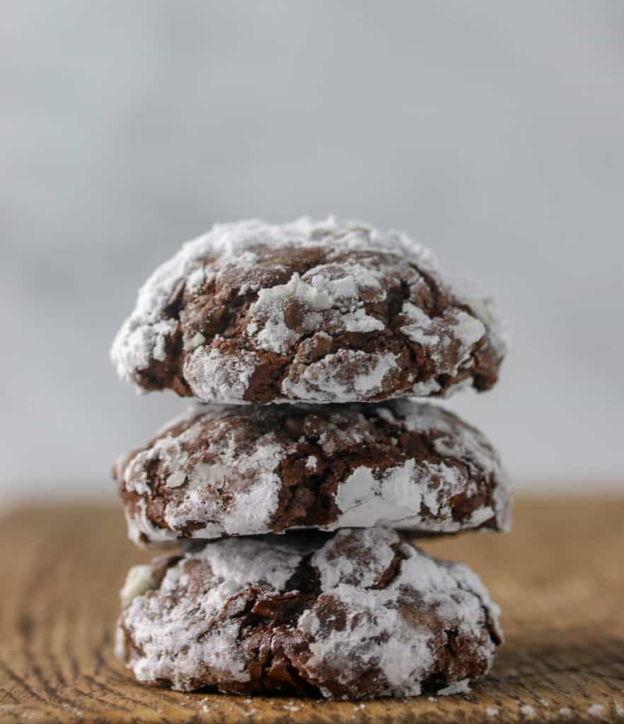three flourless fudge cookies stacked on top of each other