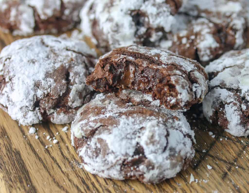flourless fudge cookies on a wood cutting board