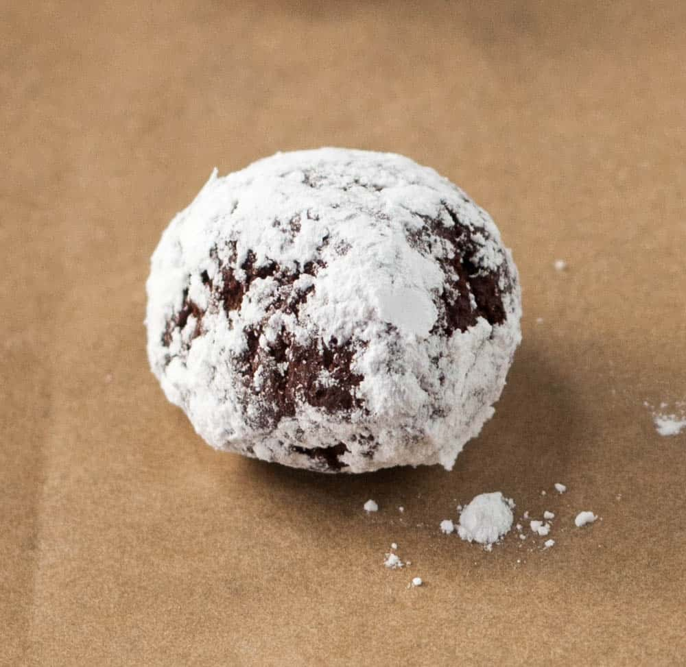 ball of cookie dough rolled in powdered sugar