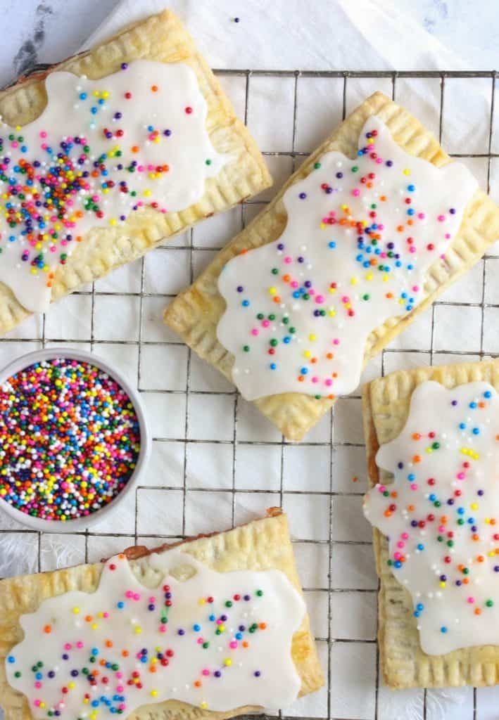 frosted strawberry poptarts on a cooling rack