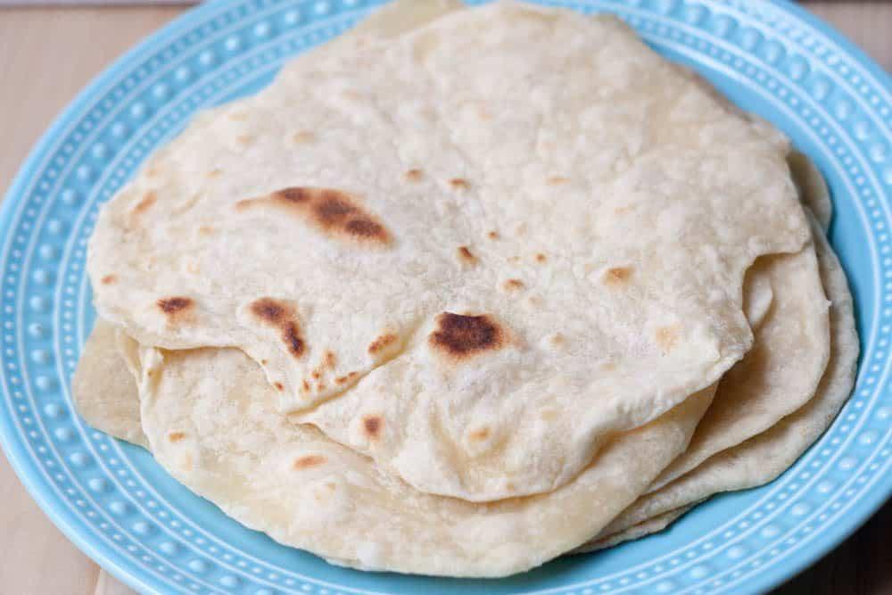 flour tortillas on a blue plate