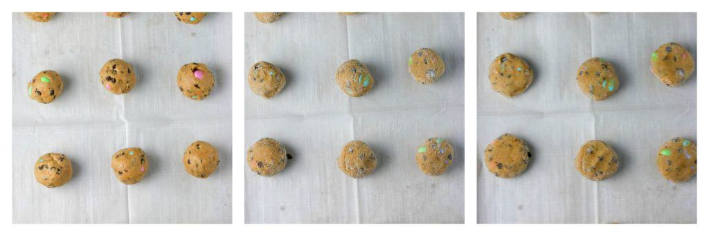 peanut butter M&M cookie dough balls on a cookie sheet