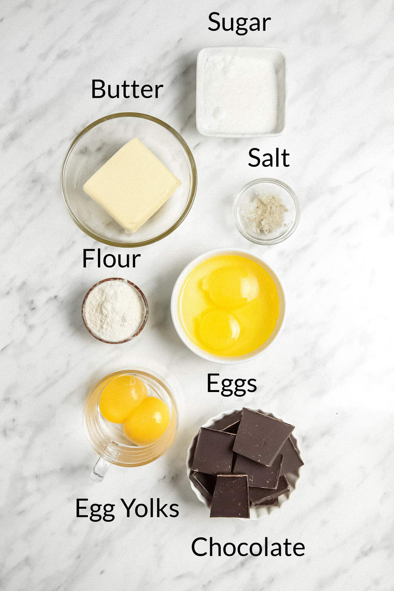 ingredients for molten cake prepped in small bowls