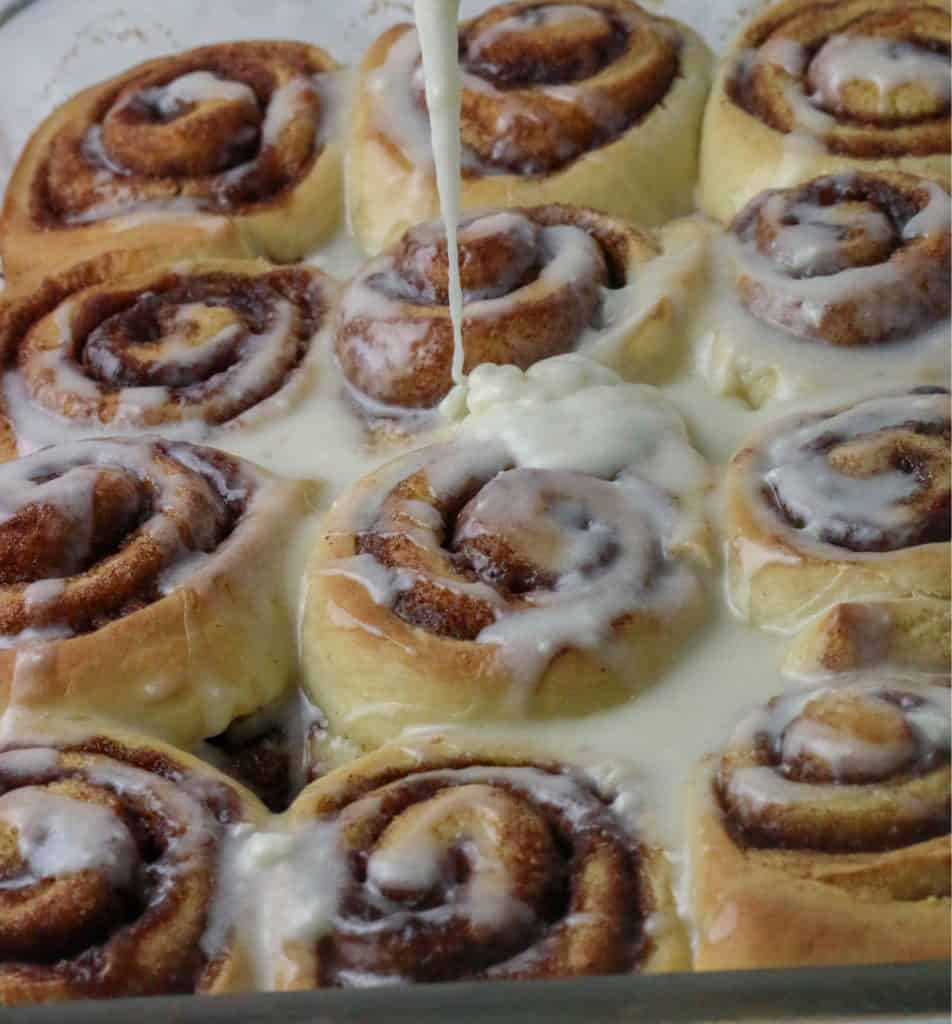 cinnamon rolls being iced