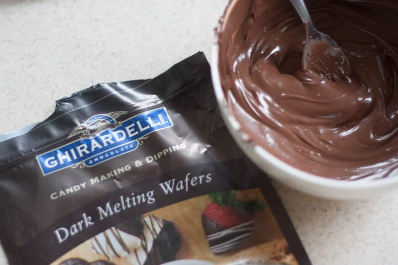 ghirardelli chocolate wafers melted in bowl to dip oreo truffles in