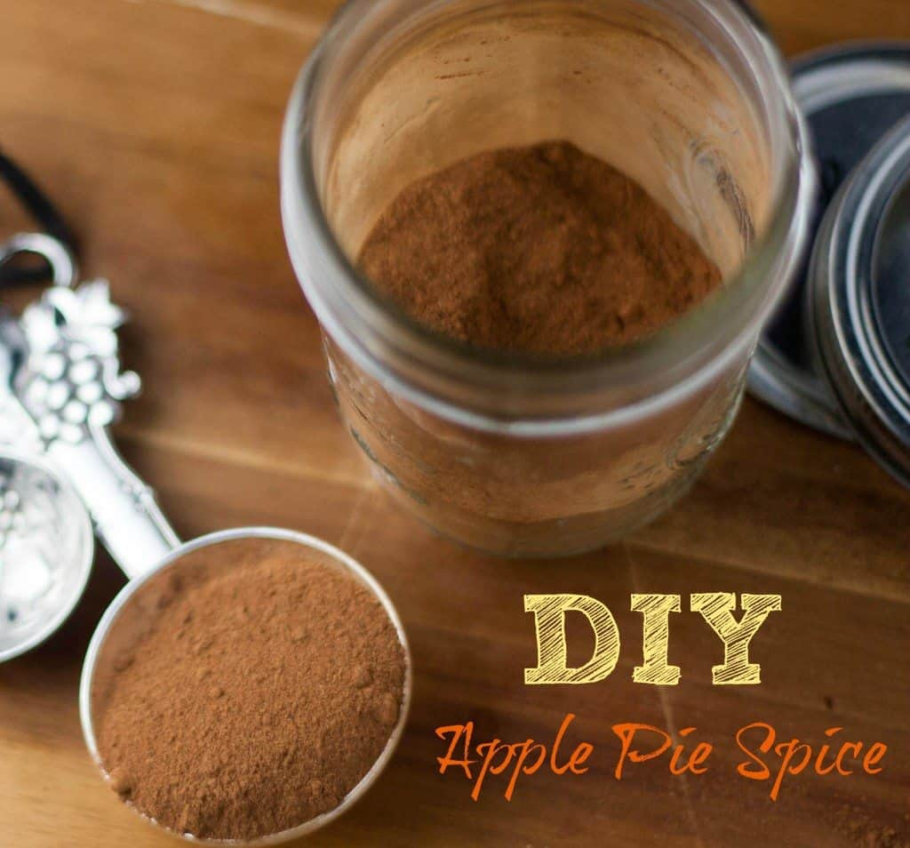 mason jar and measuring spoons of apple pie spice