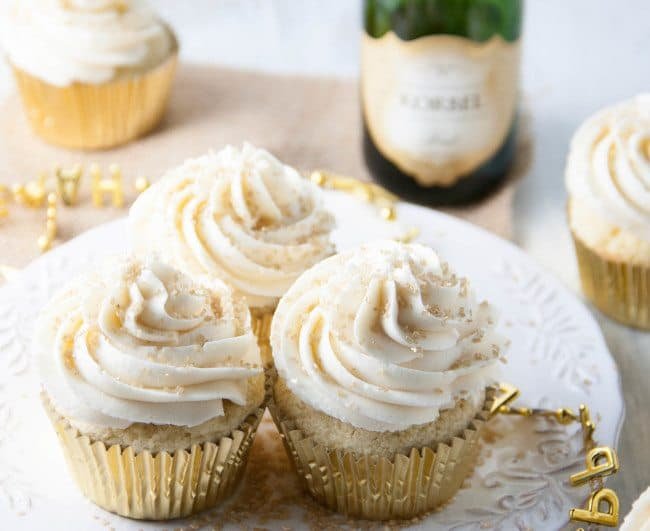 Champagne cupcakes with champagne buttercream on a plate