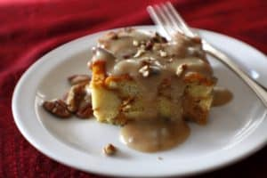 pumpkin bread pudding on a plate with a fork