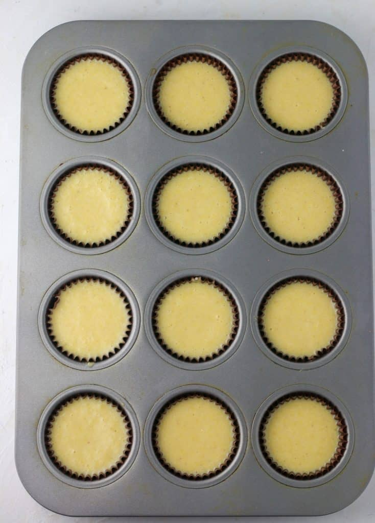 muffins tin with liners filled with batter