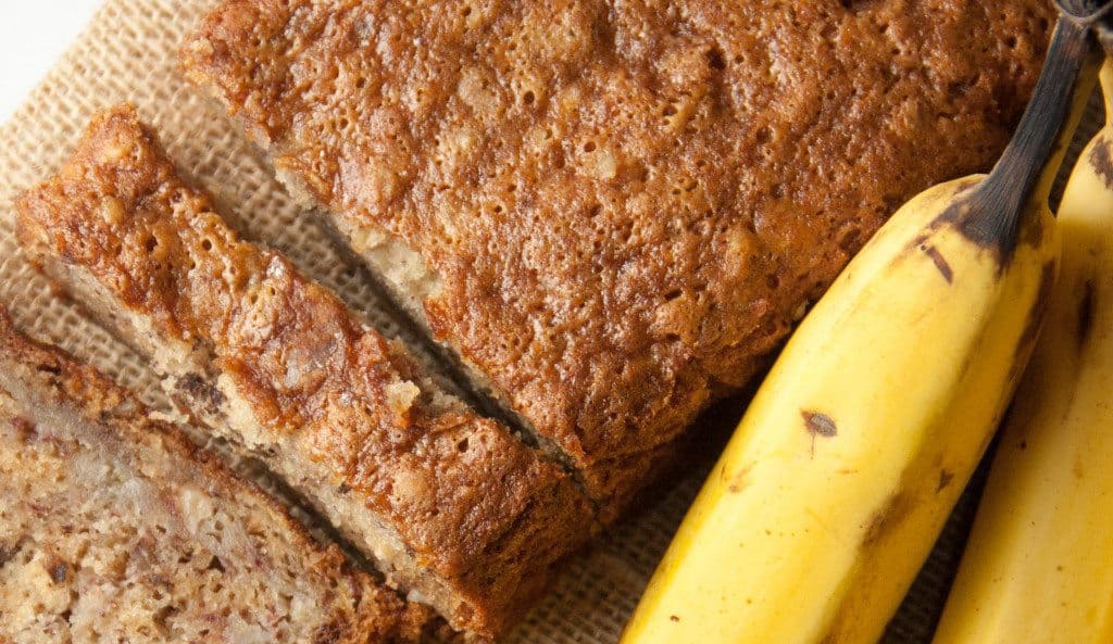 loaf of banana bread with bananas