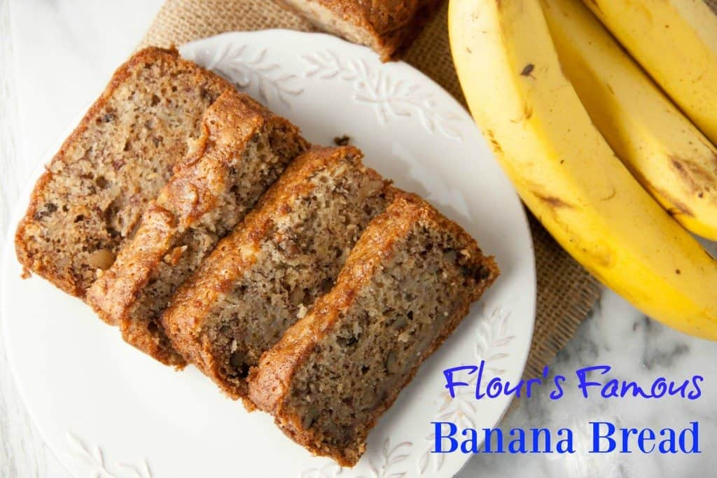 four slices of banana bread on a white plate
