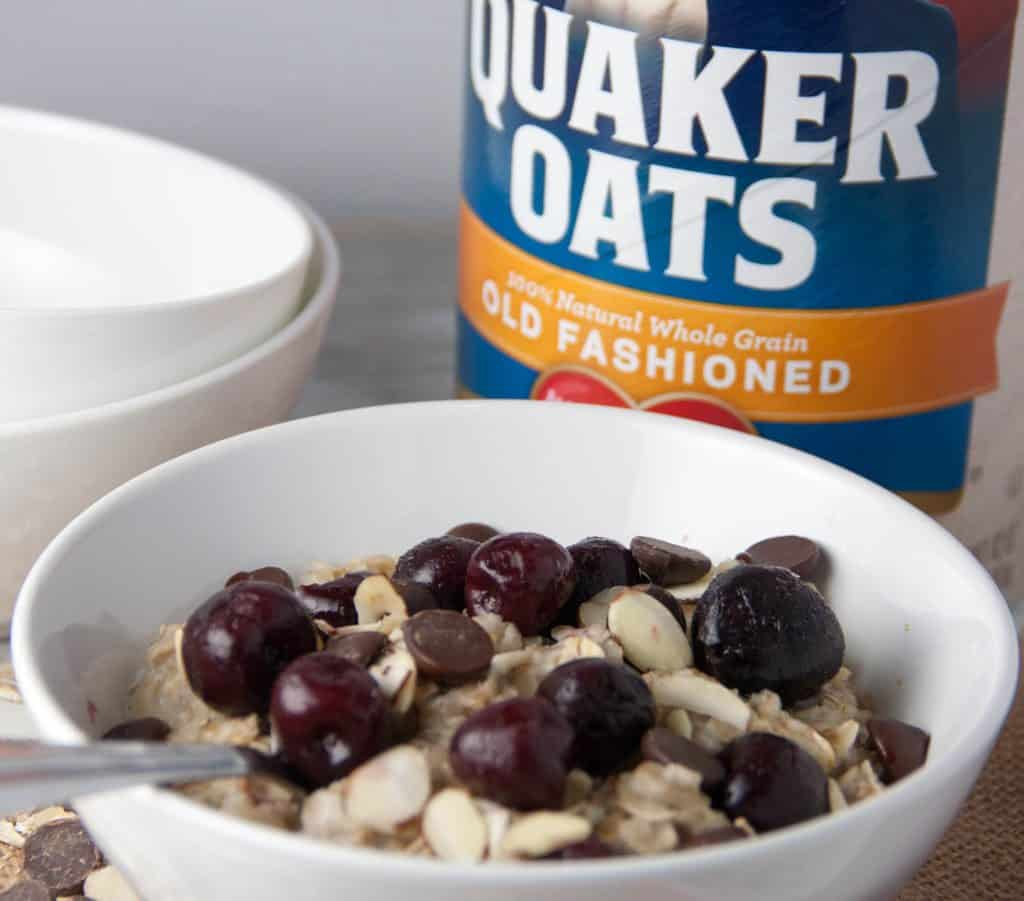 bowl of oatmeal with box of quaker oats