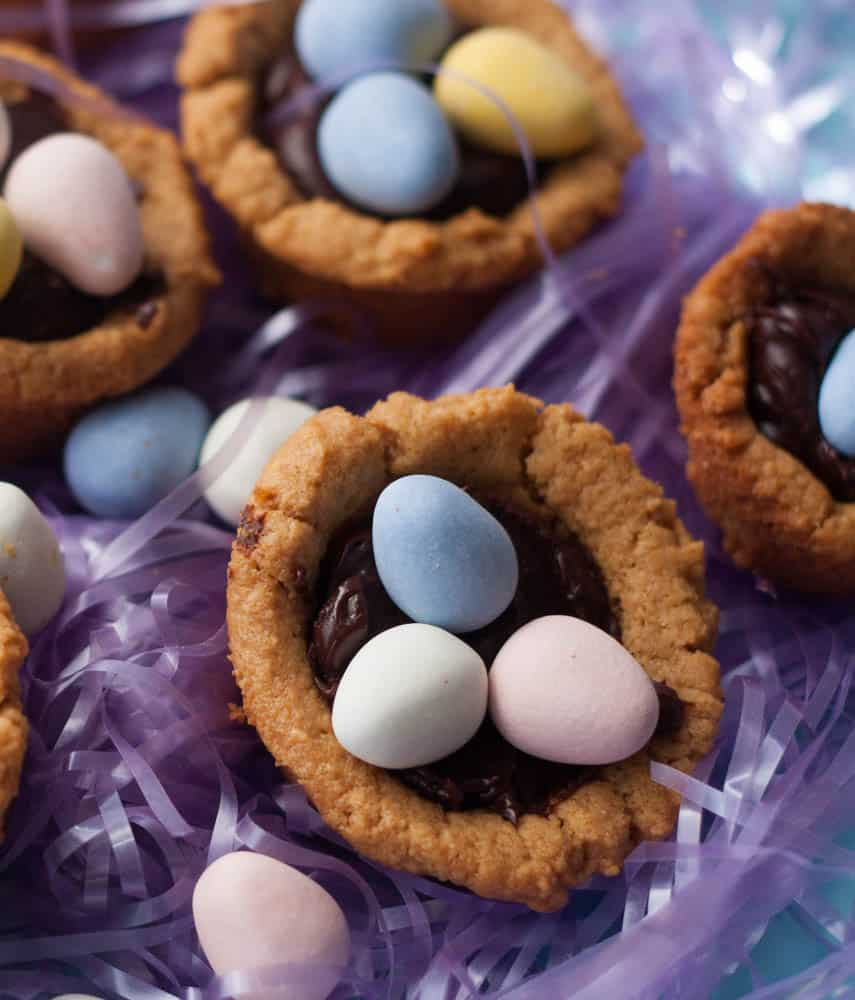 peanut butter cup filled with ganache and three mini chocolate eggs