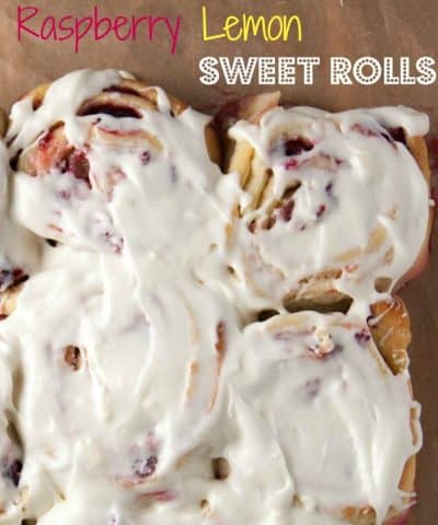 Sweet Rolls made 100% from scratch made with lemon zest, frozen raspberries, and topped with a tangy lemon cream cheese frosting. Perfect for a Mother's day brunch!