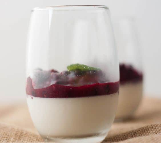 stemless wine cup filled with panna cotta and fruit compote on top