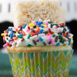 Vanilla cupcakes with a marshmallow buttercream frosting and topped with a rice krispie treat!