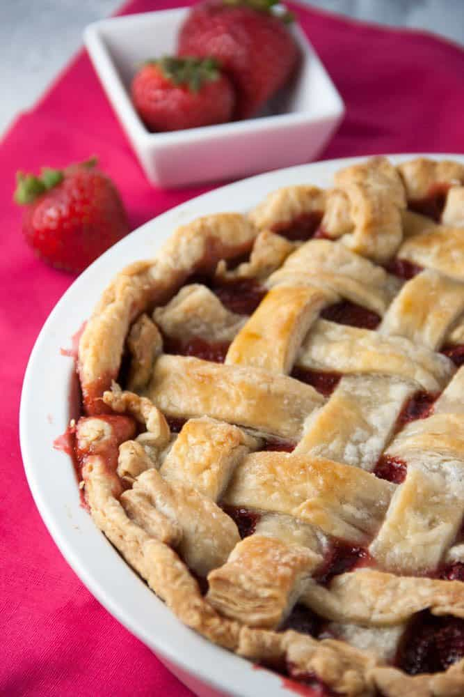 a lattice topped strawberry pie