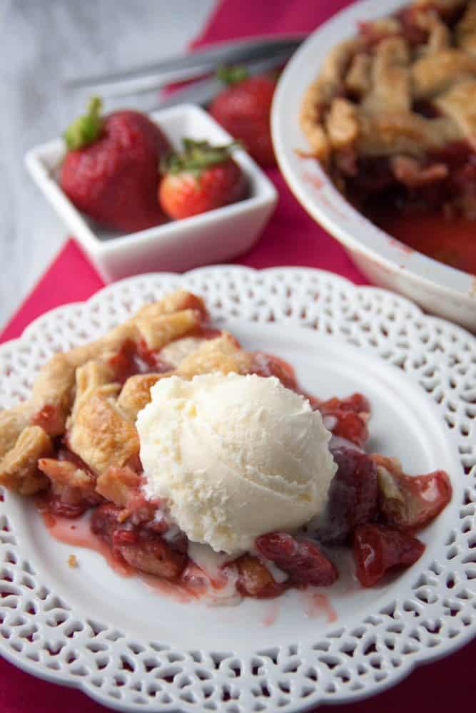 slice of strawberry pie with icecream on top