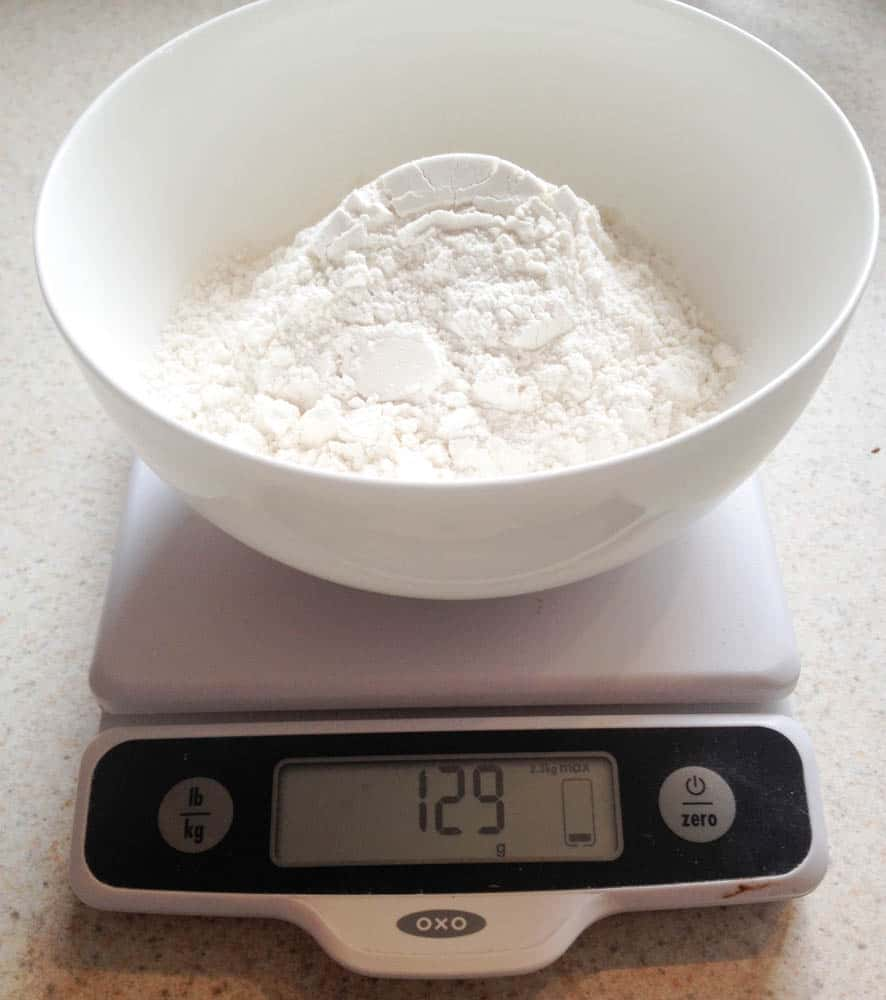 a bowl of flour on a scale