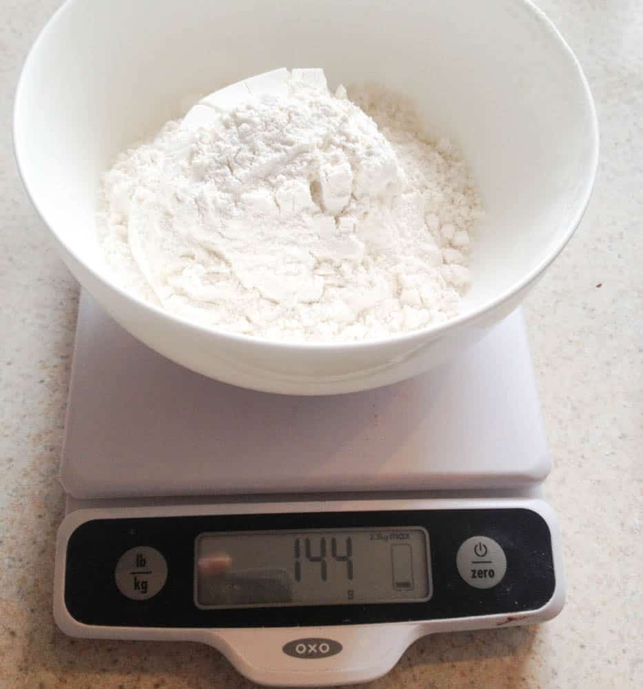 bowl of flour on a kitchen scale